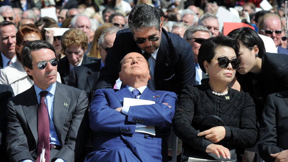 Former Italian Prime Minister Silvio Berlusconi, center, attends the ceremony.