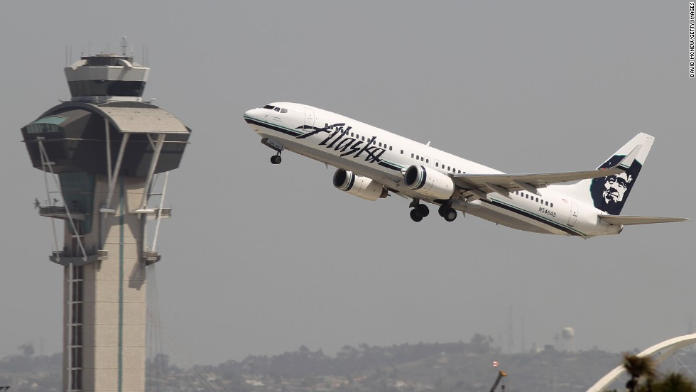 """Air traffic controllers, some safety inspectors and other essential employees will """"continue working in order to maintain the safety of the national airspace system,"""" said the Federal Aviation Administration. (File photo)"""