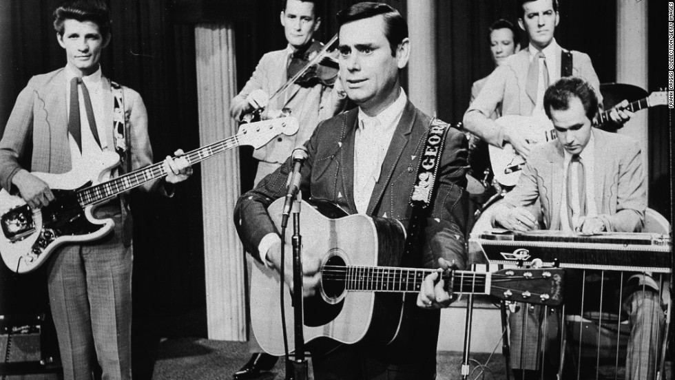 Jones performs with his band on stage for the film, 'From Nashville With Music,' in 1969.