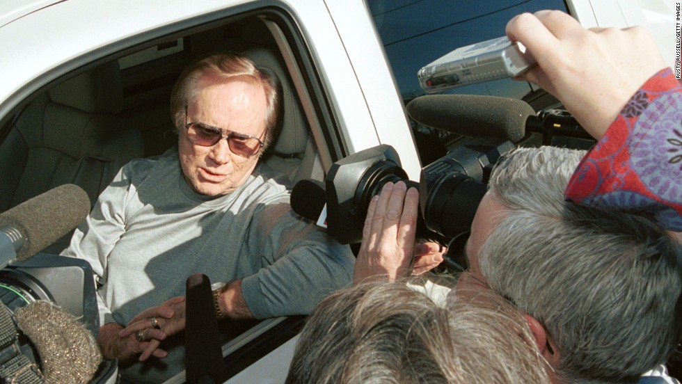 Jones talks with reporters in Nashville before greeting protesters who were rallying in front of WSM Radio studios against radio format changes in January 2002.