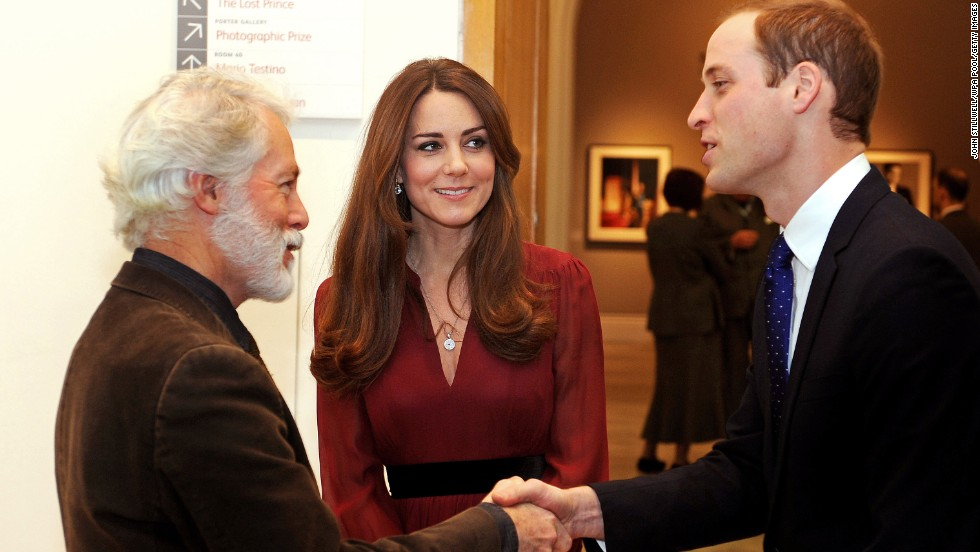 "Prince William shakes hands with artist Paul Emsley as Catherine looks on after viewing his <a href=""http://www.cnn.com/2013/01/11/world/europe/duchess-of-cambridge-first-portrait"">new portrait of the Duchess</a> during a private viewing at the National Portrait Gallery on January 11."