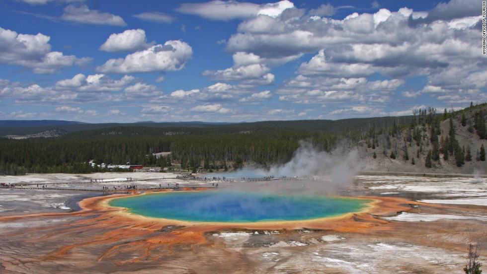 Located within a 9,000-square-kilometer chunk of Wyoming, Yellowstone National Park contains half of the globe's known geothermal features, and is home to wildlife including grizzlies, wolves and bison.