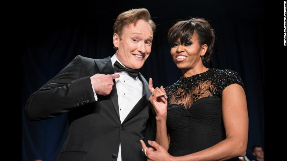 Comedian Conan O'Brien and first lady Michelle Obama joke around.