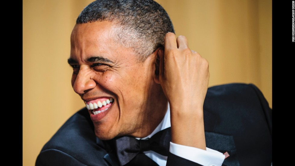 President Barack Obama laughs.