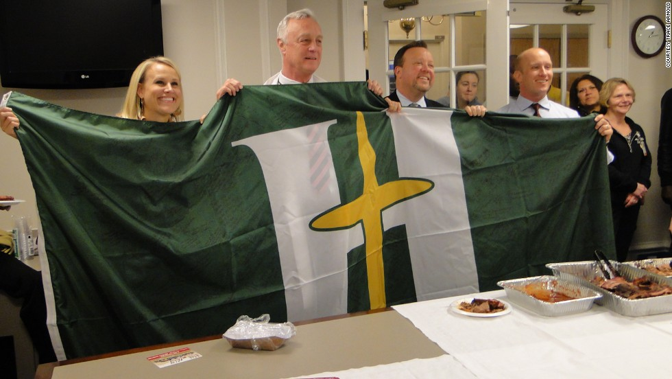 Doctors and nurses at Hillcrest signed their flag with encouraging messages for the Massachusetts General staff.