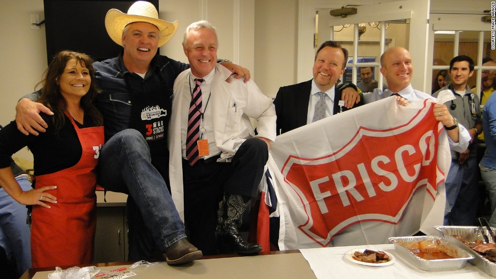 Trace Arnold brings barbecue to Massachusetts General Hospital in Boston on April 23 after staff there sent food to a hospital in Texas. Arnold, second from left, runs the 3 Stacks Smoke & Tap House in Frisco, Texas.