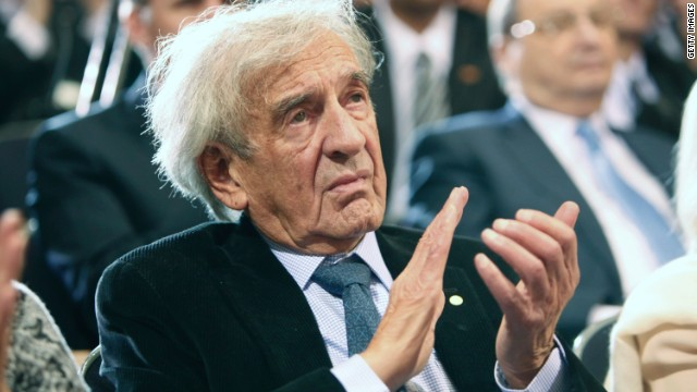 Elie Wiesel claps as U.S. President Barack Obama speaks at the Holocaust Museum April 23, 2012 in Washington, DC.