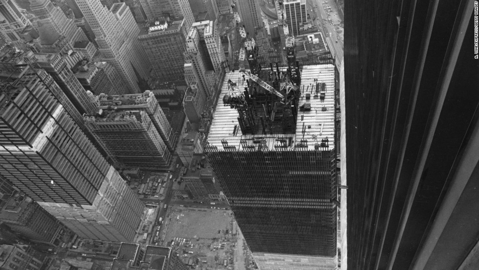 Engineers built the towers without masonry, relying on an innovative structural model using a rigid hollow tube of steel columns, shown through a rooftop view in 1971.