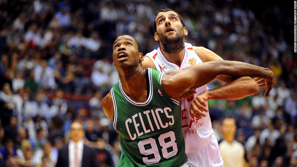 Collins competes with Ioannis Bourousis of Armani during the NBA Europe Live game in 2012 in Milan, Italy.