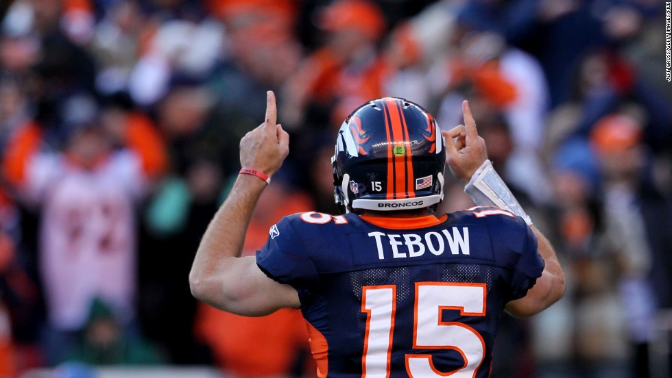 Tebow celebrates after running for a touchdown during the Broncos' playoff win against Pittsburgh in January 2012. The Broncos defeated the Steelers 29-23 in overtime.
