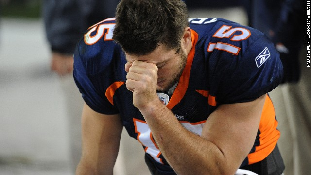 Tim Tebow prays during the final minute of a game against the New York Jets in Denver in 2011.