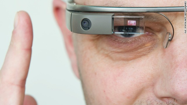 A visitor of the 'NEXT Berlin' technology conference tries out Google Glass, a wearable computer that responds to voice commands and displays information before your eyes. It is expected to go to market in late 2013.