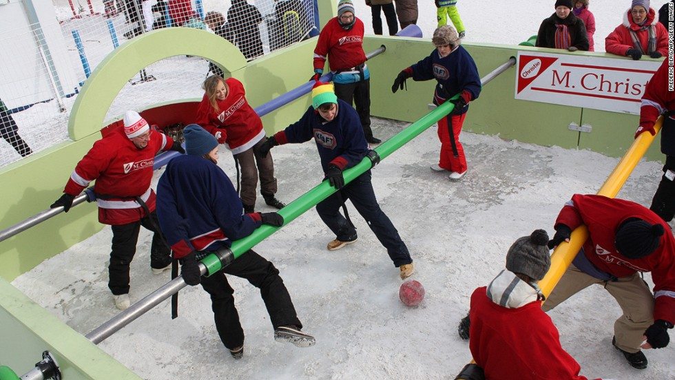 Residents play a game of human table football during the Quebec winter carnival in Quebec City. Carnaval du Quebec is held every February in Quebec City, and the success and sheer size of the event is a testament to Quebecers' defiance toward the cold.<br />