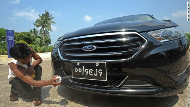 A worker polishes a Ford during an event by US carmaker Ford in Yangon on April 30, 2013.