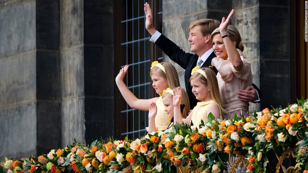 King Willem-Alexander, Queen Maxima and their children, left to right, Catharina-Amalia, Princess of Orange, Princess Alexia, and Princess Ariane wave to the crowd gathered on Dam Square.