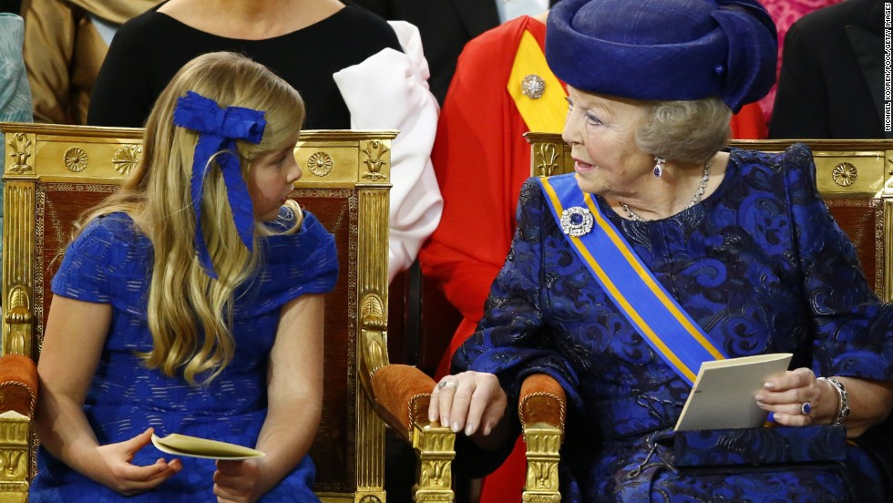 Princess Beatrix sits with her grandaughter Catharina-Amalia, Princess of Orange, during the investiture ceremony.