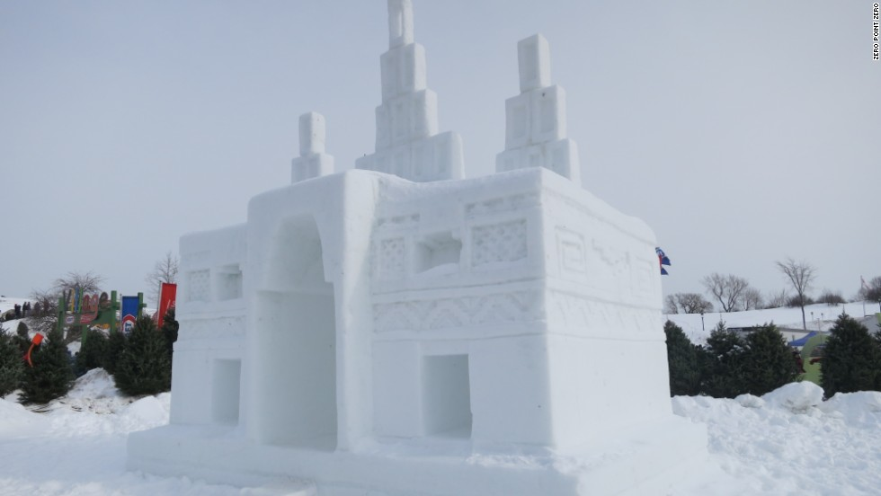 "The crew of ""Anthony Bourdain Parts Unknown"" stops to admire an ice castle at the Quebec Winter Carnival."