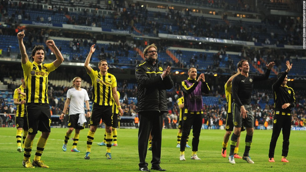 Dortmund manager Jurgen Klopp celebrates with his players following the 2-0 defeat which allowed his side to qualify for the final 4-3 on aggregate. It is the first time since 1997 that Dortmund has reached the final when it defeated Juventus 3-1.