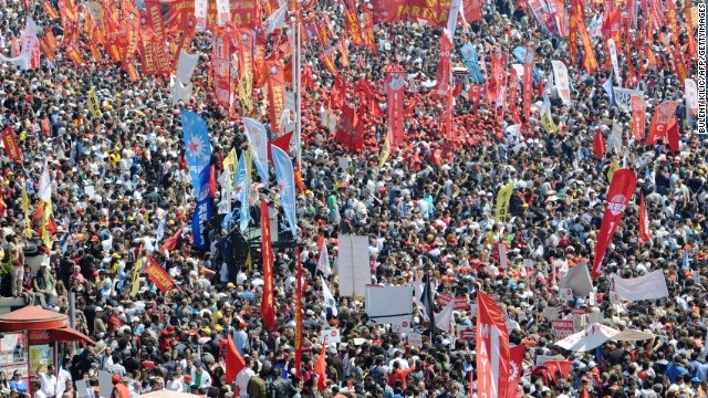 Thousands of Turkish protestors gather at Taksim square during a May Day rally in central Istanbul, on May 1, 2012. Tens of thousands of workers gathered at the iconic square in the heart of Turkey's biggest city Istanbul to celebrate May Day. AFP PHOTO/BULENT KILIC (Photo credit should read BULENT KILIC/AFP/GettyImages)