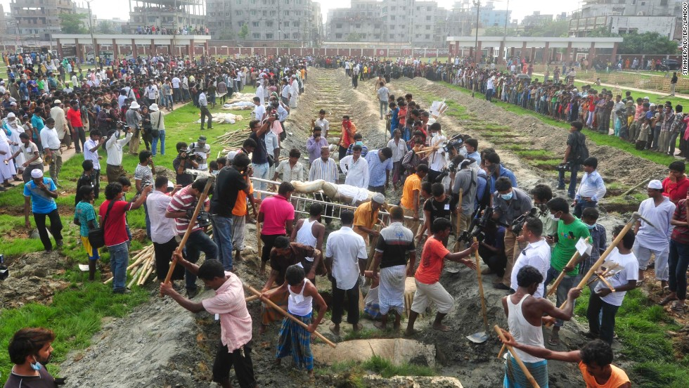 Workers dig graves during a mass burial of unidentified garment workers on May 1.