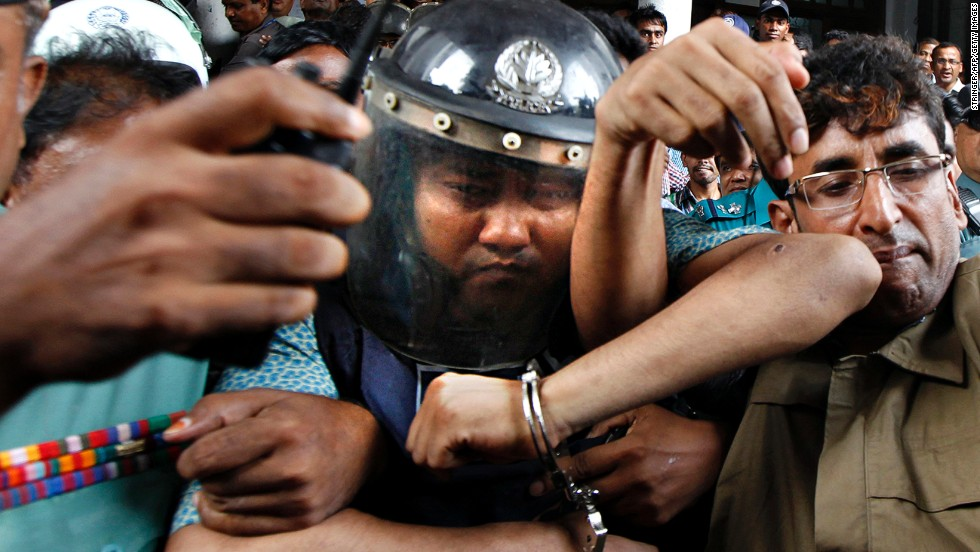 Sohel Rana, owner of the collapsed Rana Plaza building, wears police-issued body armor and a helmet while being escorted to court in Dhaka on Tuesday, April 30. Rana was arrested near the Indian border, and protesters called for him to be hanged.