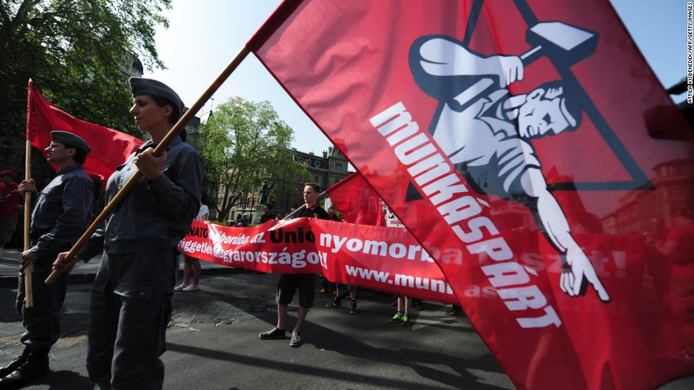 "Members and sympathizers of the Hungarian communist party, the ""Munkaspart,"" march in Budapest."