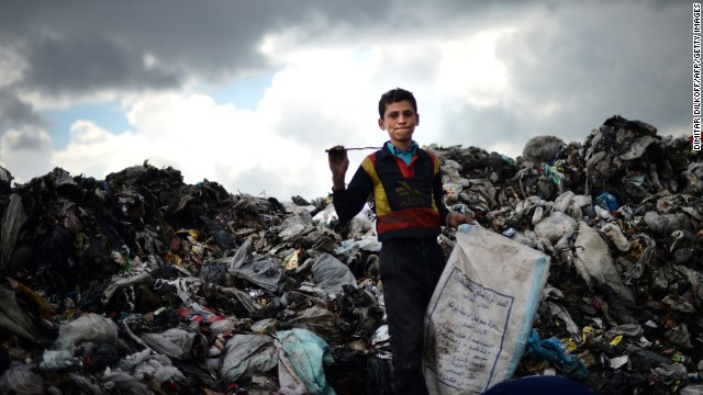 A young Syrian boy collects plastic and metal items in a garbage dump in the northern Syrian city of Aleppo earlier in April.