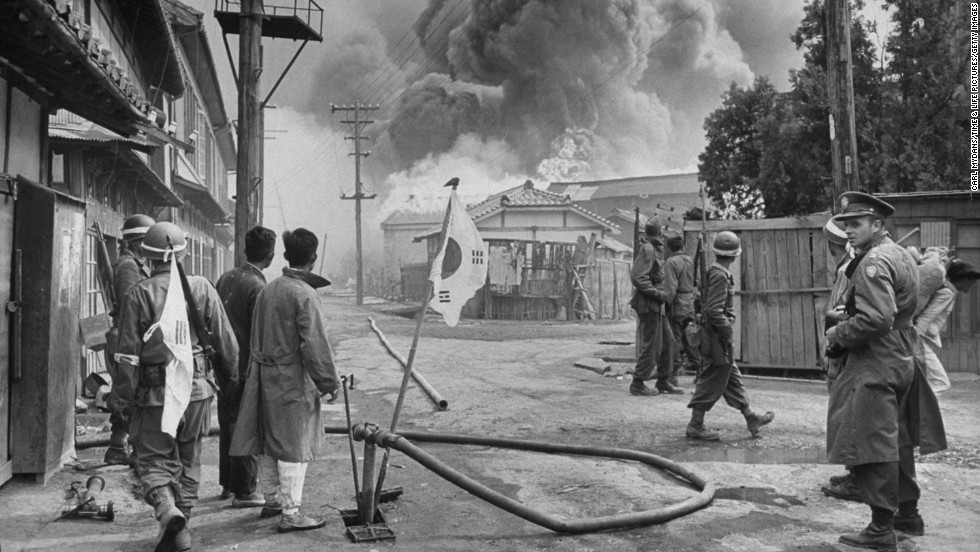 "Korean and U.S. soldiers watch large fires consume a village during an uprising in 1948. Two years before the Korean Peninsula erupted in a civil war, communist rebels -- many of whom had been in the American-trained Korean army -- revolted against President Syngman Rhee's regime. Photographer Carl Mydans was on the ground when the rebellion began. Most of his pictures have never been published before. <a href=""http://life.time.com/history/korea-photos-from-the-october-1948-rebellion/"" target=""_blank"">View more at LIFE.com.</a>"