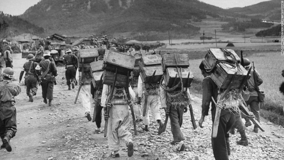 "South Korean soldiers advance toward the front lines. <a href=""http://life.time.com/history/korea-photos-from-the-october-1948-rebellion/"" target=""_blank"">View more at LIFE.com.</a>"