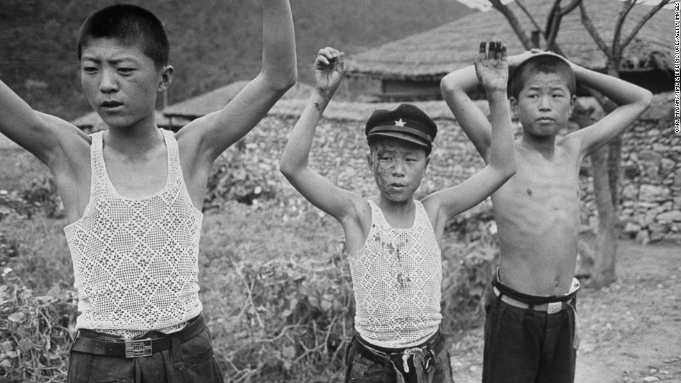 A group of young suspected communist rebels surrender to South Korean soldiers.