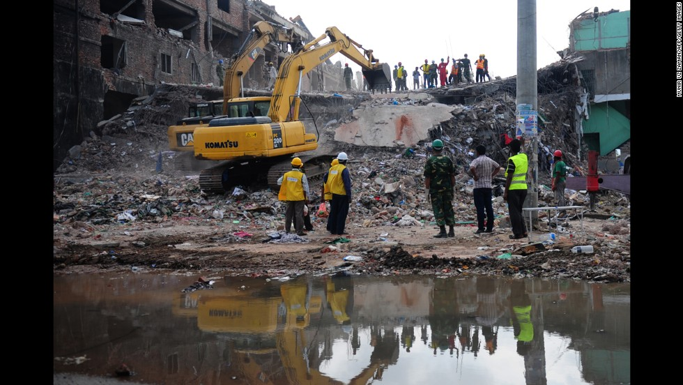 Rescue workers move debris as Bangladeshi army personnel continue the second phase of a rescue operation at the site of the collapsed building in Savar on May 2.