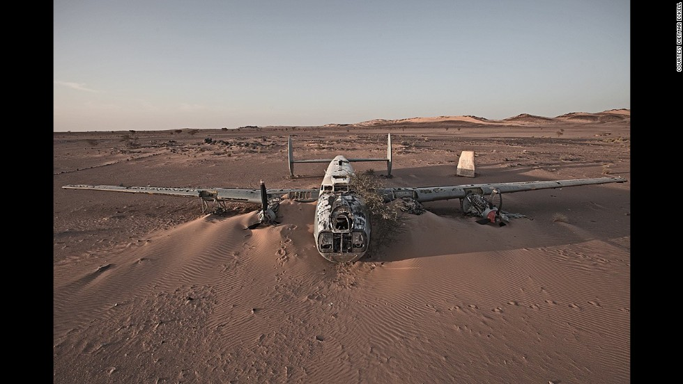 """An Avro Shackleton, a British-made maritime patrol aircraft, is swallowed by the sand in Western Sahara. A local rebel group helped Eckell reach the site from Mauritania. """"We had to go cross-country, as the military would stop us on the gravel roads -- a different kind of thrill."""""""