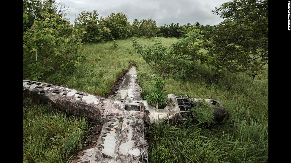 """<a href=""""http://www.dietmareckell.com/?splash=1"""" target=""""_blank"""">Dietmar Eckell's bid to photograph what he calls """"miracles in aviation history""""</a> -- airplanes that were forced down without loss of life -- has taken him from African deserts to Papua New Guinean swamps, like this photo. <br /><br />""""In Papua New Guinea, hiking to the plane was like a time travel -- you pass villages where nothing has changed in the 70 years since the plane landed,"""" says Eckell. """"No electricity, running water, and they still go fishing in the dug-out canoes."""" The B-24D Liberator, an American heavy bomber, has rested in this swamp since 1943, during World War II."""