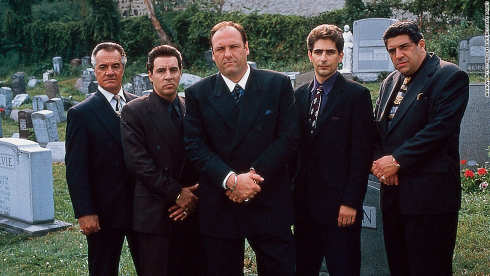 "Quite possibly the biggest anticlimax in TV history: Tony Soprano (James Gandolfini, center) meets his family in a restaurant and looks up, and then, with Journey's ""Don't Stop Believin' "" playing in the background, the screen cuts to black. ""Sopranos"" fans have long debated the ending: Did Tony die or not? Creator David Chase has walked through the scene in detail but hasn't said one way or another."
