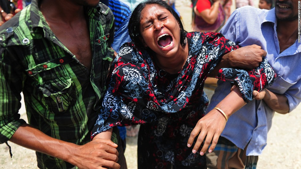 A woman reacts on May 3 after identifying a body found in the rubble.