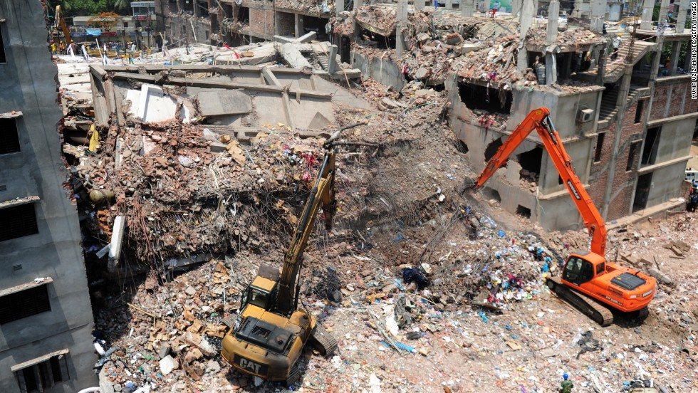 Rescue workers dig out debris from the Rana Plaza building as Bangladeshi army personnel continue the second phase of a rescue operation using heavy equipment on Friday, May 3.
