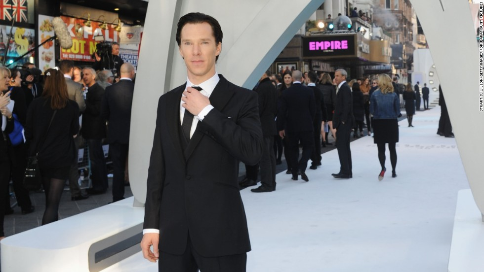 "Benedict Cumberbatch adjusts his tie at the U.K. premiere of his new movie, ""Star Trek Into Darkness."""