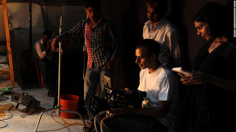"A cinematographer checks his footage on the set of the Bollywood movie ""Go Goa Gone"" at Film City in Mumbai on April 8."