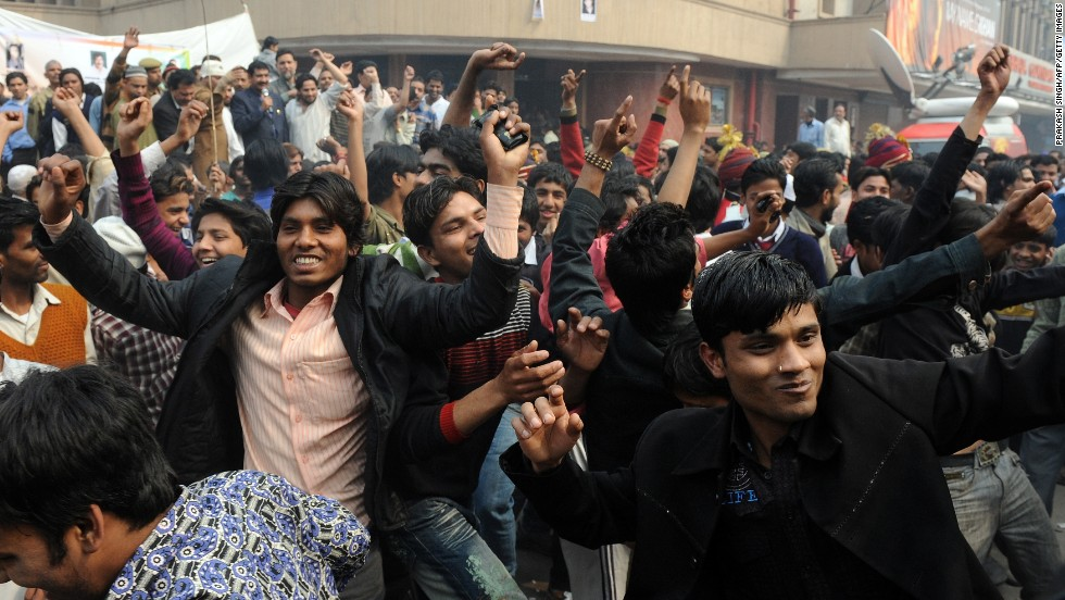 "Fans of Indian actor Shah Rukh Khan dance outside a theater in New Delhi set to show his film ""My Name is Khan"" on February 12, 2010."