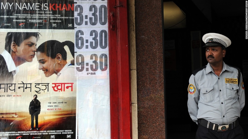 "A security guard stands outside a movie theater in Mumbai premiering the film ""My Name Is Khan"" on February 10, 2009."