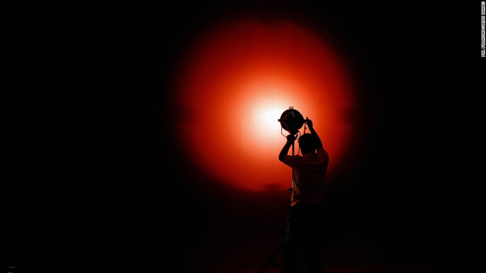 A lighting assistant makes adjustments on set at Kamlistan Studio in Mumbai on September 5, 2007.