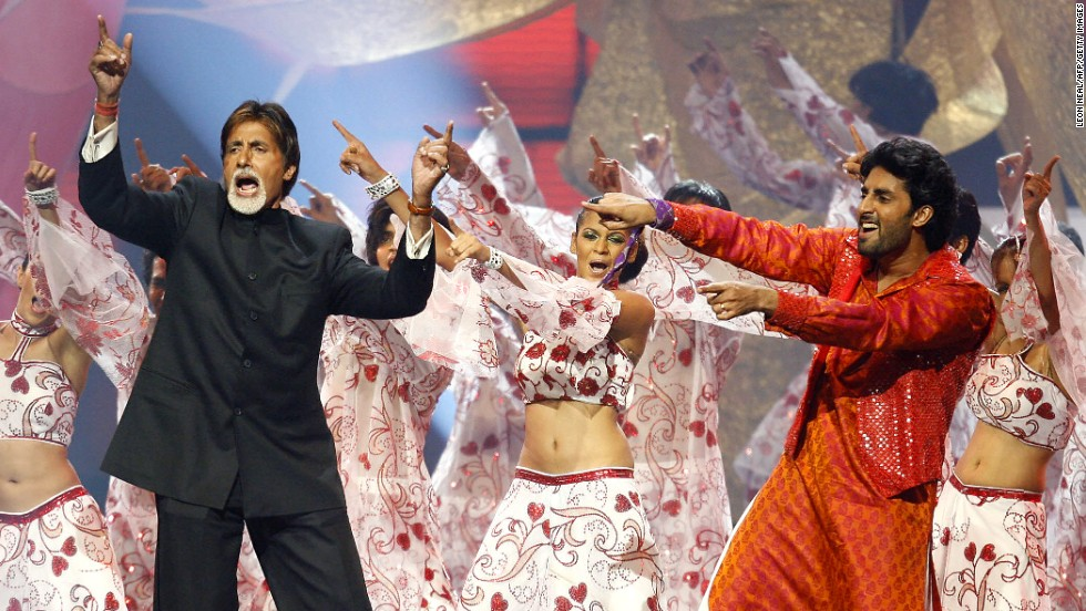 Actor Amitabh Bachchan, left, performs with his son, Abhishek Bachchan, at the International Indian Film Academy Awards ceremony in Sheffield, England, on June 9, 2007. The event is known as the Bollywood Oscars.