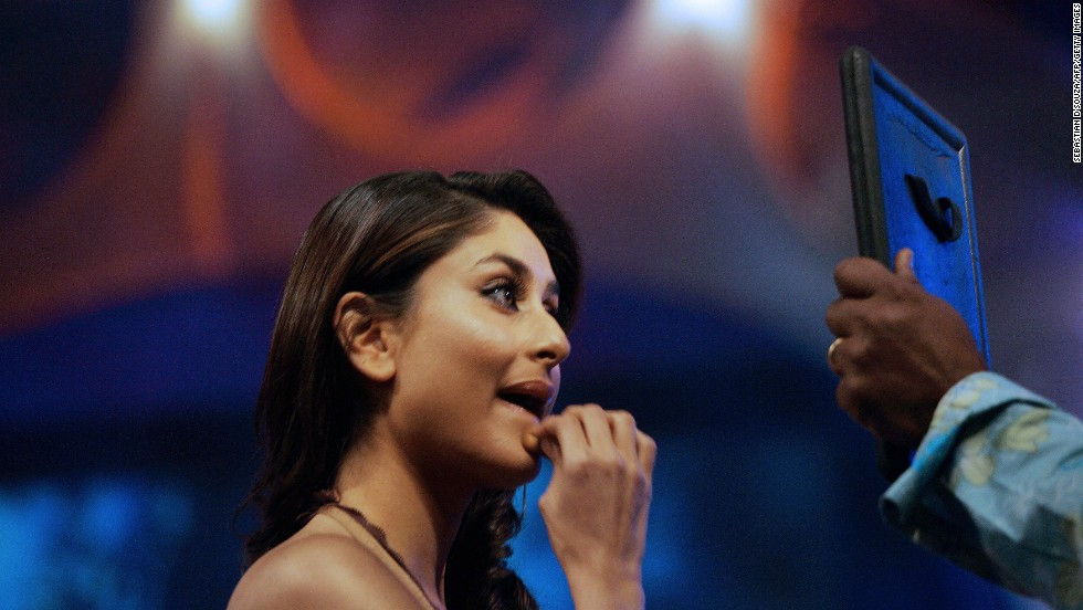 "Actress Kareena Kapoor touches up her makeup on the set of ""Indian Idol"" in Mumbai on February 4, 2006. She was a guest judge on the popular TV show."