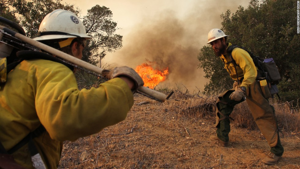 Firefighters based out of the Lone Peak Conservation Center in Draper, Utah, build a fire break as a wildfire continues to grow on May 3, near Camarillo, California.