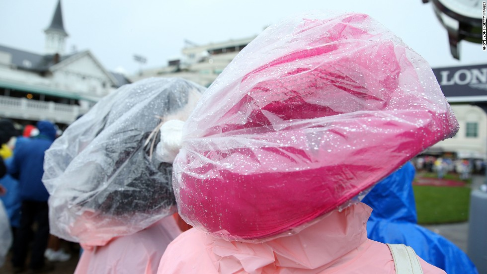 Derby hats are swathed in plastic to keep out the wet.