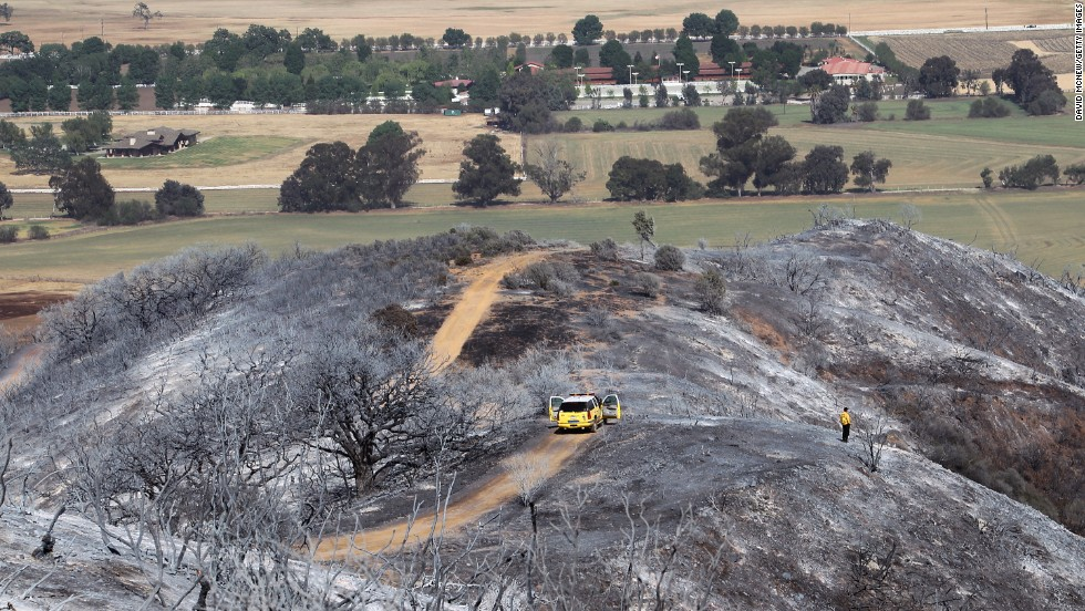 A firefighter surveys the burned hills from the Springs Fire near Camarillo on May 4.