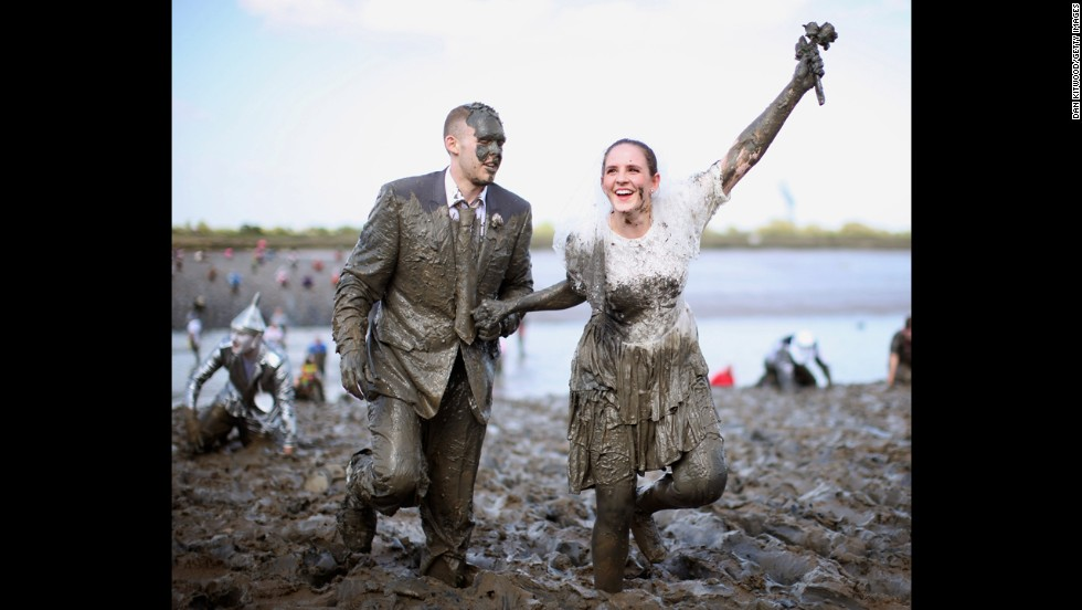 A couple dressed as a bride and groom take part in race. It's held in the town of Maldon, east of London.