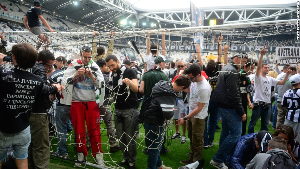 The Turin side's fans invaded the pitch at the Alps stadium after the match to get mementos of Juventus' success.