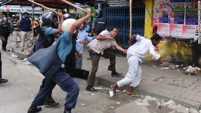 Bangladeshi police charge Islamists during clashes in Dhaka on Sunday.