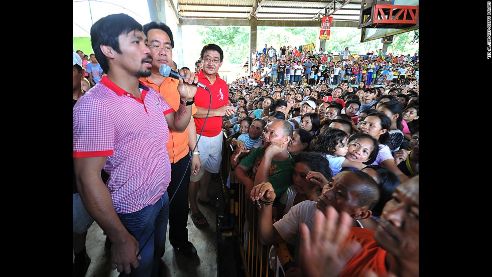 Pacquiao speaks to flood-affected residents at an evacuation center in Cagayan de Oro City, a southern island off Mindanao on December  23, 2011.